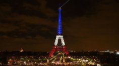 A photo taken on November 16, 2015 in Paris shows the Eiffel Tower illuminated with the colours of the French national flag in tribute to the victims of November 13 Paris terror attacks which killed at least 129 people in scenes of carnage at a concert hall, restaurants and the national stadium. AFP PHOTO / ERIC FEFERBERG